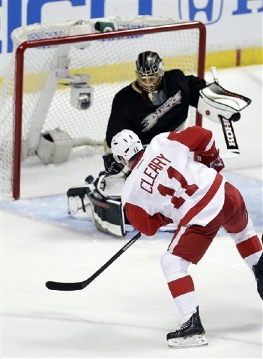 Detroit Red Wings right wing Daniel Cleary, left, scores past Anaheim Ducks goalie Jonas Hiller during the first period in Game 1 of their first-round NHL hockey Stanley Cup playoff series in Anaheim, Calif., Tuesday, April 30, 2013. (AP Photo/Chris Carlson)