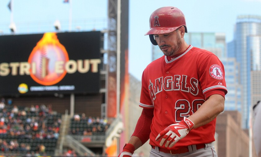 Angels pinch hitter Matt Joyce heads back to the dugout after striking out in the eighth inning of an 8-1 loss to the Twins.