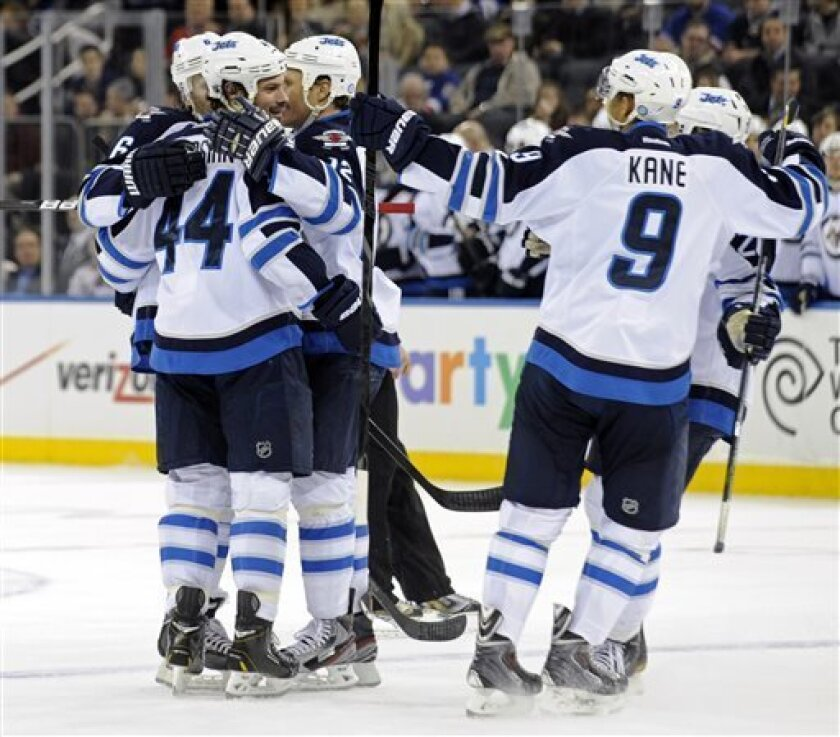 Winnipeg Jets' Zach Bogosian (44) celebrates his goal with teammates during the first period of an NHL hockey game against the New York Rangers on Monday, April 1, 2013, at Madison Square Garden in New York.  (AP Photo/Bill Kostroun)