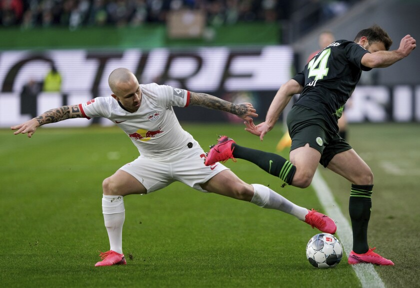 Leipzig's Angelino, left, and Wolfsburg's Admir Mehmedi, right, challenge for the ball during the German Bundesliga soccer match between VfL Wolfsburg and RB Leipzig in Wolfsburg, Germany, Saturday, March 7, 2020. (Peter Steffen/dpa via AP)