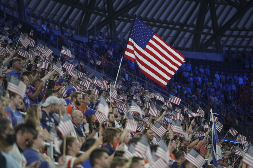 FC Cincinnati fans wave American flags in remembrance of the 20th anniversary of the September 11th terrorist attacks.