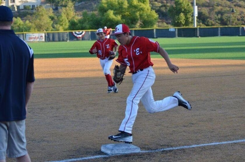 Encinitas Juniors standout Jobe Cubillian tags first base for the final out of an inning. At left is Pete Gagne. ELL is now playing in the Western Region tournament and looking for a berth in the Juniors World Series.