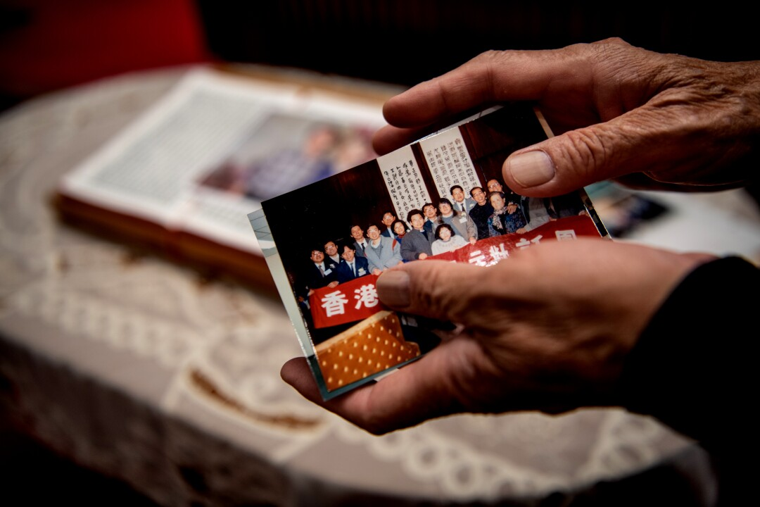 Reverend Chu Yiu-ming looks at a picture of a delegation of Hong Kong pro-democracy activists in Beijing in the late 1980s.