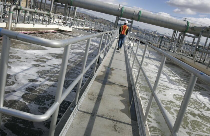 Steve Smullen, area operations manager of the U.S. section of the International Boundary and Water Commission, walks on a passage way at the International Wastewater Treatment Plant in the Tijuana River Valley. The treatment plant was expanded in hopes of meeting U.S. Clean Water Act standards for