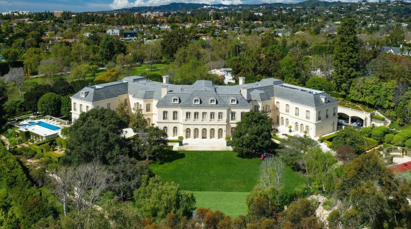 "In 56,500 square feet, the ""W""-shaped mansion has 123 rooms, including 14 bedrooms and 27 bathrooms."