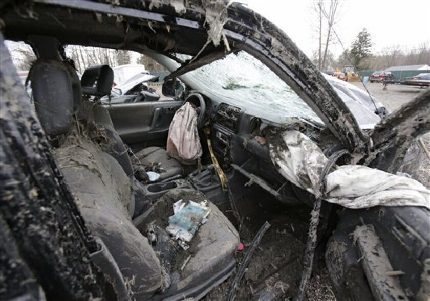 This Monday, March 11, 2013 photo in Southington, Ohio shows the interior of a vehicle where six people died in a crash early Sunday in Warren, Ohio. Two teens who escaped the crash that killed six friends in a swampy pond wriggled out of the wreckage by smashing a rear window and swimming away fro