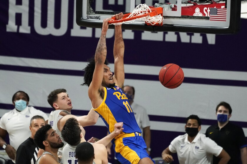 Pittsburgh's Justin Champagnie (11) dunks against Northwestern during the second half of an NCAA college basketball game in Evanston, Ill., Wednesday, Dec. 9, 2020. (AP Photo/Nam Y. Huh)