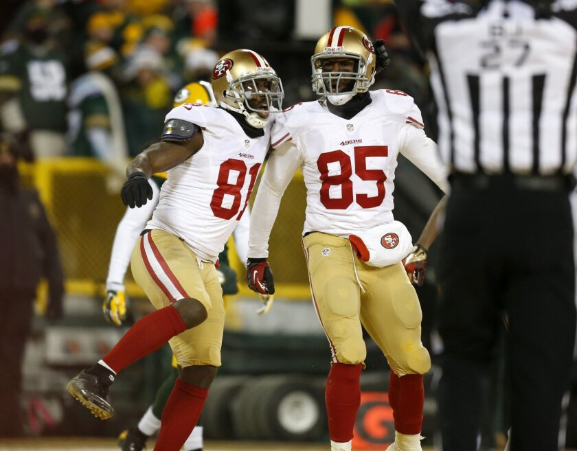 San Francisco 49ers' Vernon Davis celebrates his touchdown catch with San Francisco 49ers' Anquan Boldin against the Green Bay Packers.