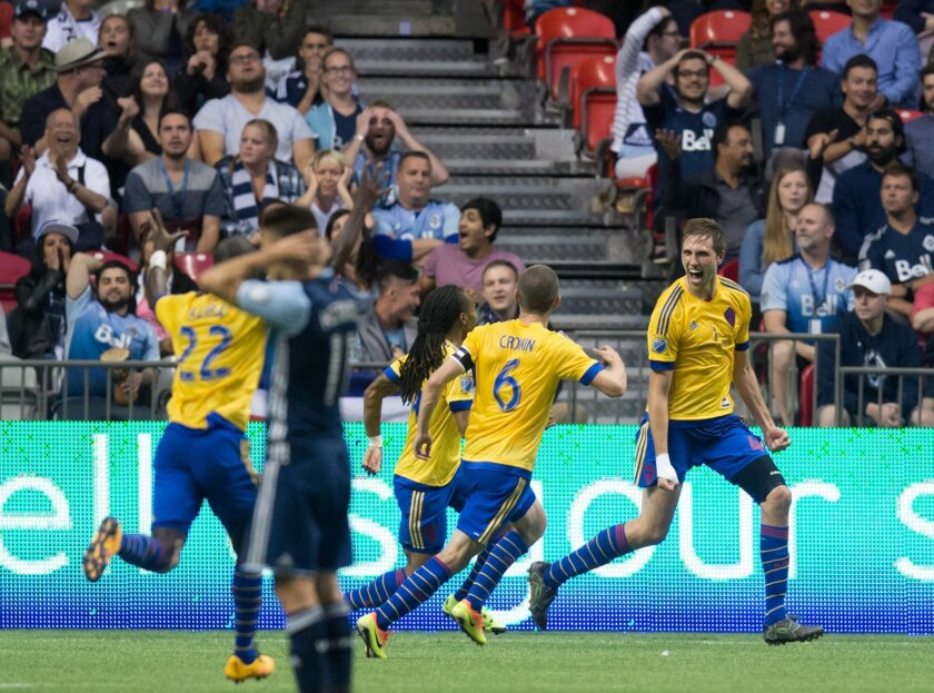 Colorado Rapids' Axel Sjoberg, right, celebrates with teammates Micheal Azira (22), Sam Cronin (6) and Marlon Hairston after scoring the tying goal against the Vancouver Whitecaps during the second half of an MLS soccer match Saturday, July 9, 2016, in Vancouver, British Columbia. (Darryl Dyck/The Canadian Press via AP)