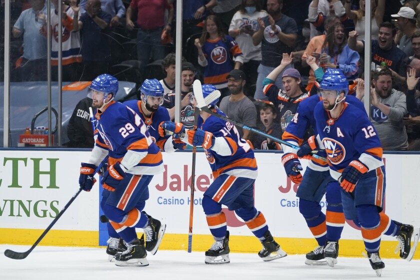 New York Islanders' Brock Nelson (29) celebrates with teammates after scoring a goal during the second period of Game 6 during an NHL hockey second-round playoff series against the Boston Bruins Wednesday, June 9, 2021, in Uniondale, N.Y. (AP Photo/Frank Franklin II)