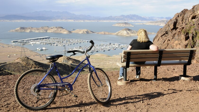 Visitors enjoy scenic views of Lake Mead National Recreation Area on the Historic Railroad Trail. Th