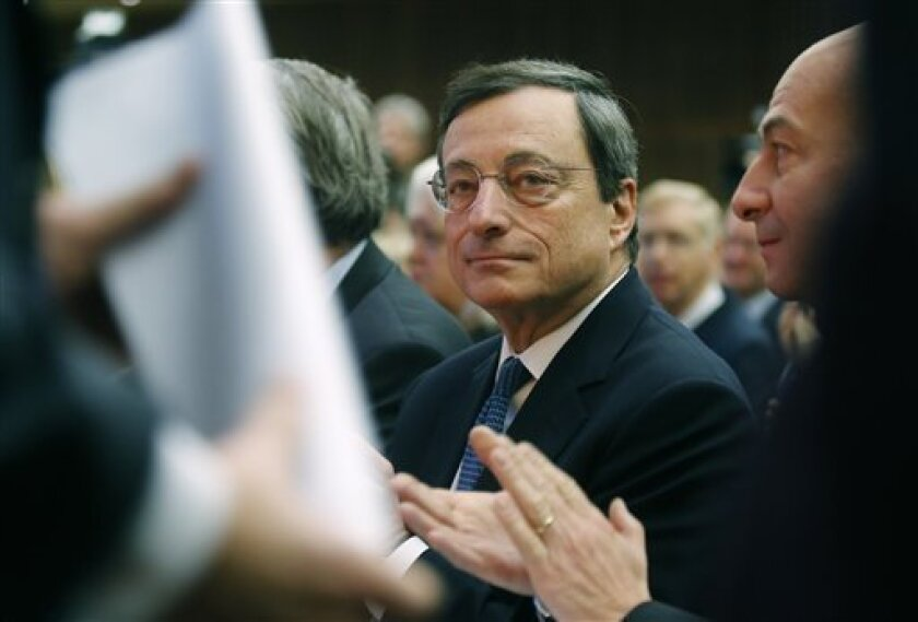 "European Central Bank president Mario Draghi, is seen during a panel discussion on""growth and integration with solidarity, what kind of strategy for Europe?"" at the finance ministry in Paris, Friday, Nov. 30, 2012. (AP Photo/Michel Euler)"