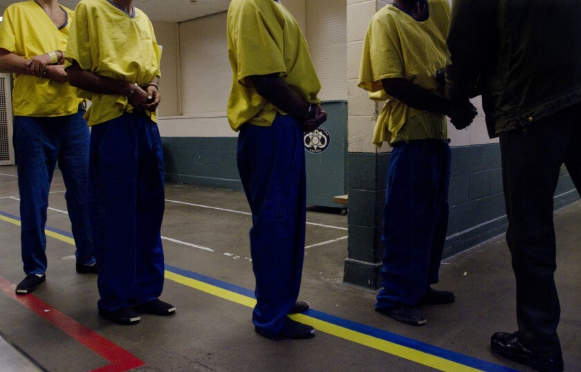 Los Angeles County Sheriff Lee Baca has proposed moving 3,000 inmates out of crowded jails, requiring them to use GPS trackers and sending them into the community. However, an audit has found issues with the reliability of the devices.