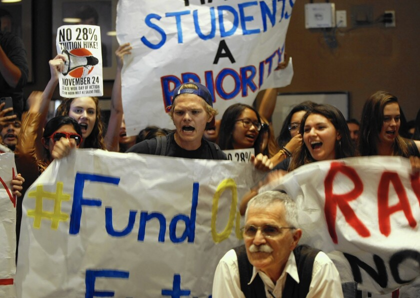 Students disrupt a meeting of administrators at UC San Diego in 2014 as part of a systemwide protest against a proposed tuition increase.