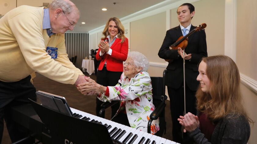 Pianist Dorothy Coleman, center, celebrates her 106th birthday with Lake San Marcos Kiwanis Club member Jerry Mason, left, San Marcos Vice Mayor Rebecca Jones and musicians Andre Ricardo, 15, and Claire Lewis.