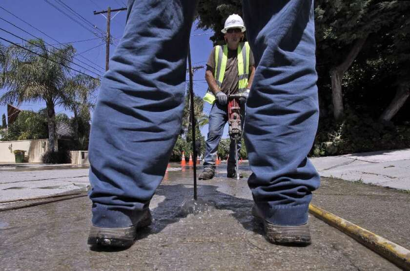 A crew with the Los Angeles Department of Water and Power works in Encino.