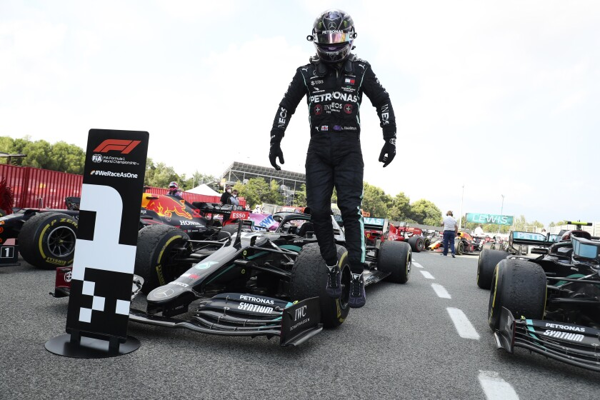 Lewis Hamilton jumps out of his car after the the Formula One Grand Prix.