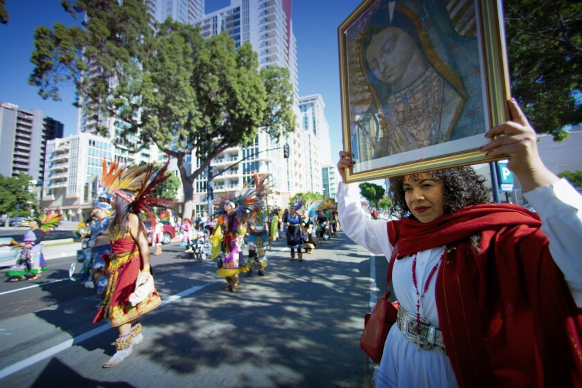 Maria Chino from San Marcos held up a large image of Our Lady of Guadalupe.