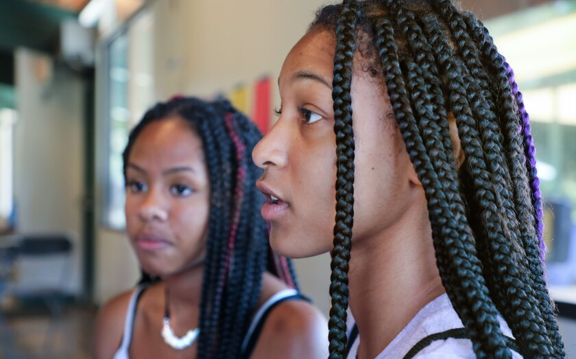 Cousins La'Ren Daniel, 15, left, and Jenell Anderson, 16, at right, of San Diego, speak about what brought them to Experience Camp.