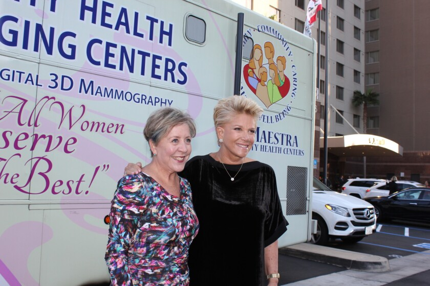 Laura Farmer Sherman (left), president and CEO of Komen San Diego, and journalist/author Joan Lunden stand in front of the mobile mammography coach.