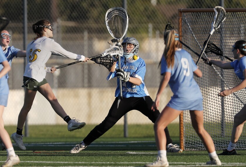 Corona del Mar High goalkeeper Katie Langley defends the net against Edison during the first half in
