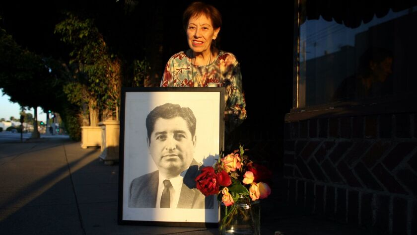 Lucy Casado, the matriarch of Lucy's El Adobe Cafe, in 2008 with a photo of Los Angeles Times columnist Ruben Salazar, who was killed by police in 1970.