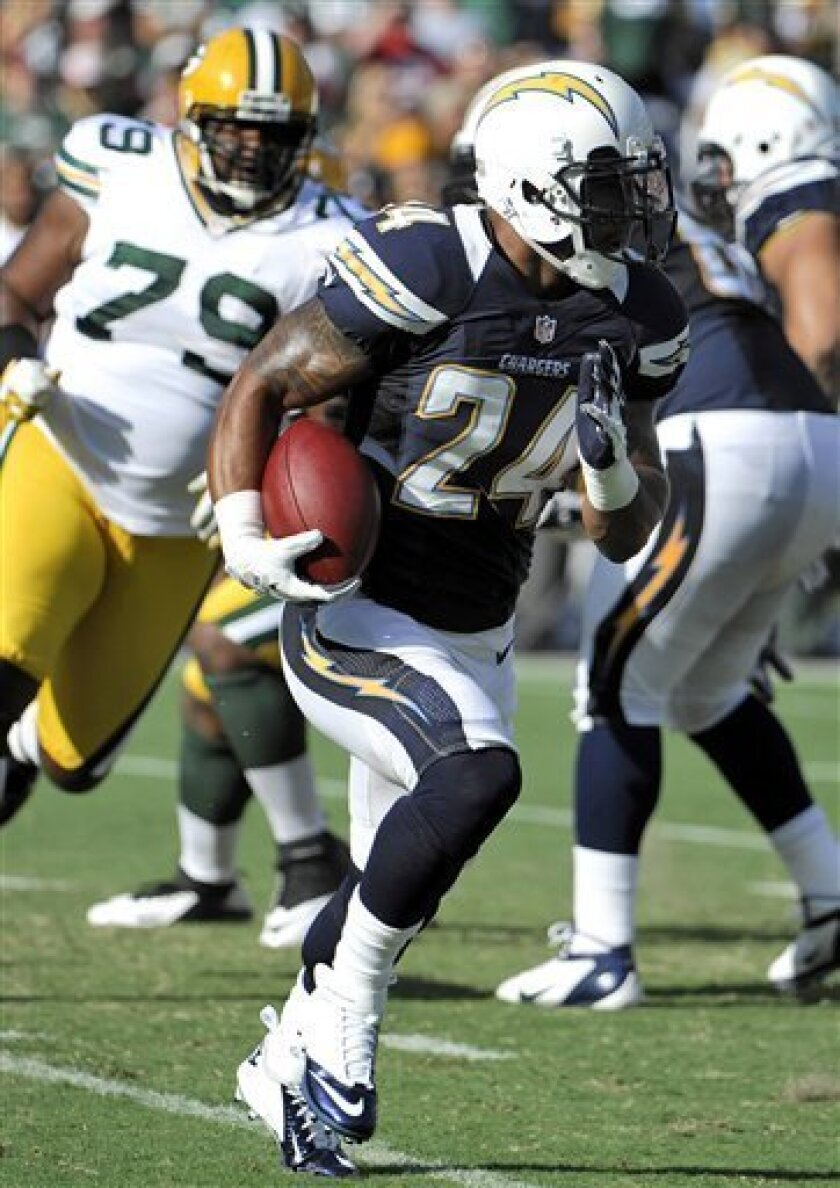 San Diego Chargers running back Ryan Mathews (24) carries the ball on his first run in an NFL preseason football game against the Green Bay Packers on Thursday, Aug. 9, 2012, in San Diego. Mathews broke his clavicle on the 5-yard run. (AP Photo/Denis Poroy)