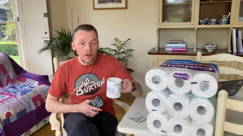 Simon Pegg next to packs of toilet paper in his coronavirus PSA.