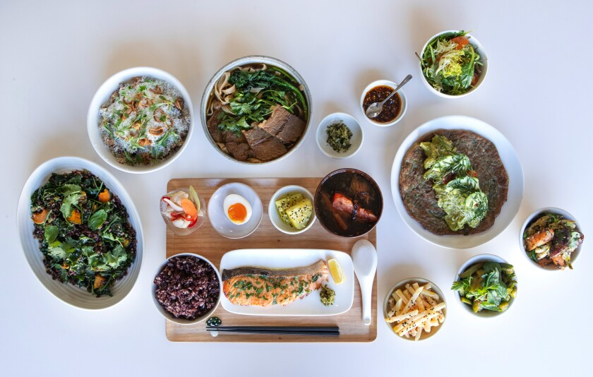 A spread of dishes, including the signature beef noodle soup (top center) at Yang's Kitchen.