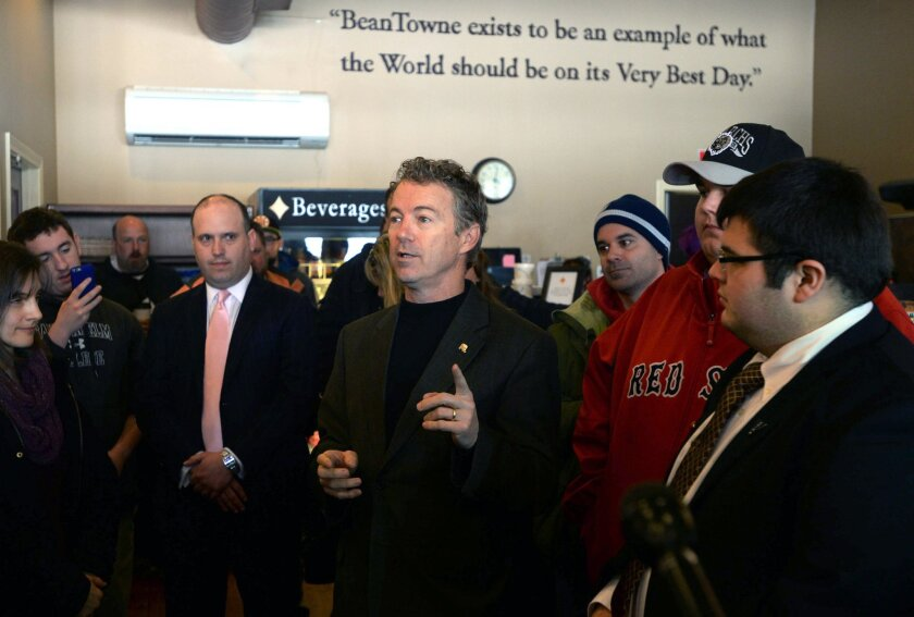 Sen. Rand Paul speaks with diners at Beantowne Coffee House & Cafe on March 21 in Hampstead, New Hampshire. Paul has made a number of trips to the state, which holds the first primary in the nation.