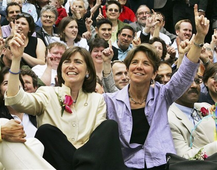 In this May 17, 2005, file photo, Julie, front left, and Hillary Goodridge pose with other gay couples and supporters as they celebrate their first wedding anniversary in Boston. The couple, who led the legal fight for Massachusetts to become the first state to legalize same-sex marriages, filed for divorce Thursday, Jan. 29, 2009. (AP Photo/Elise Amendola, File)