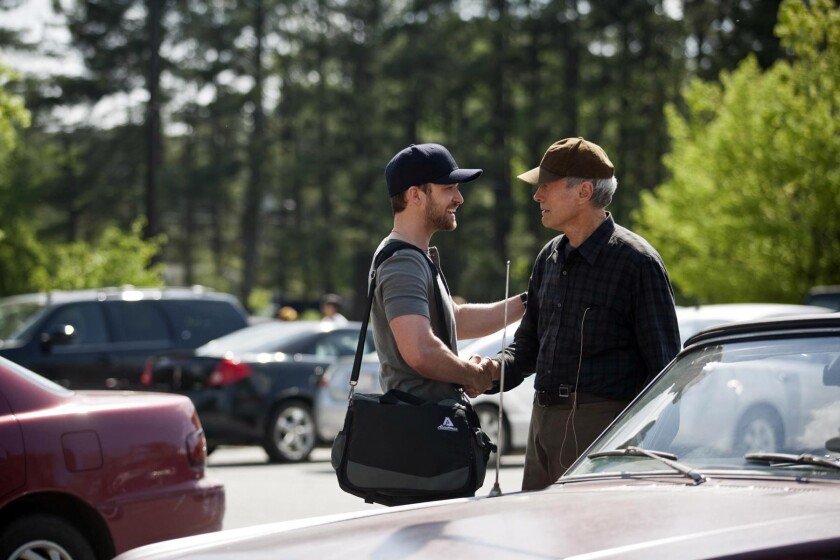 """Justin Timberlake and Clint Eastwood appear in a scene from """"Trouble With the Curve."""" A judge in Los Angeles has dismissed a suit that contended the screenplay for the movie was stolen from another writer's work."""