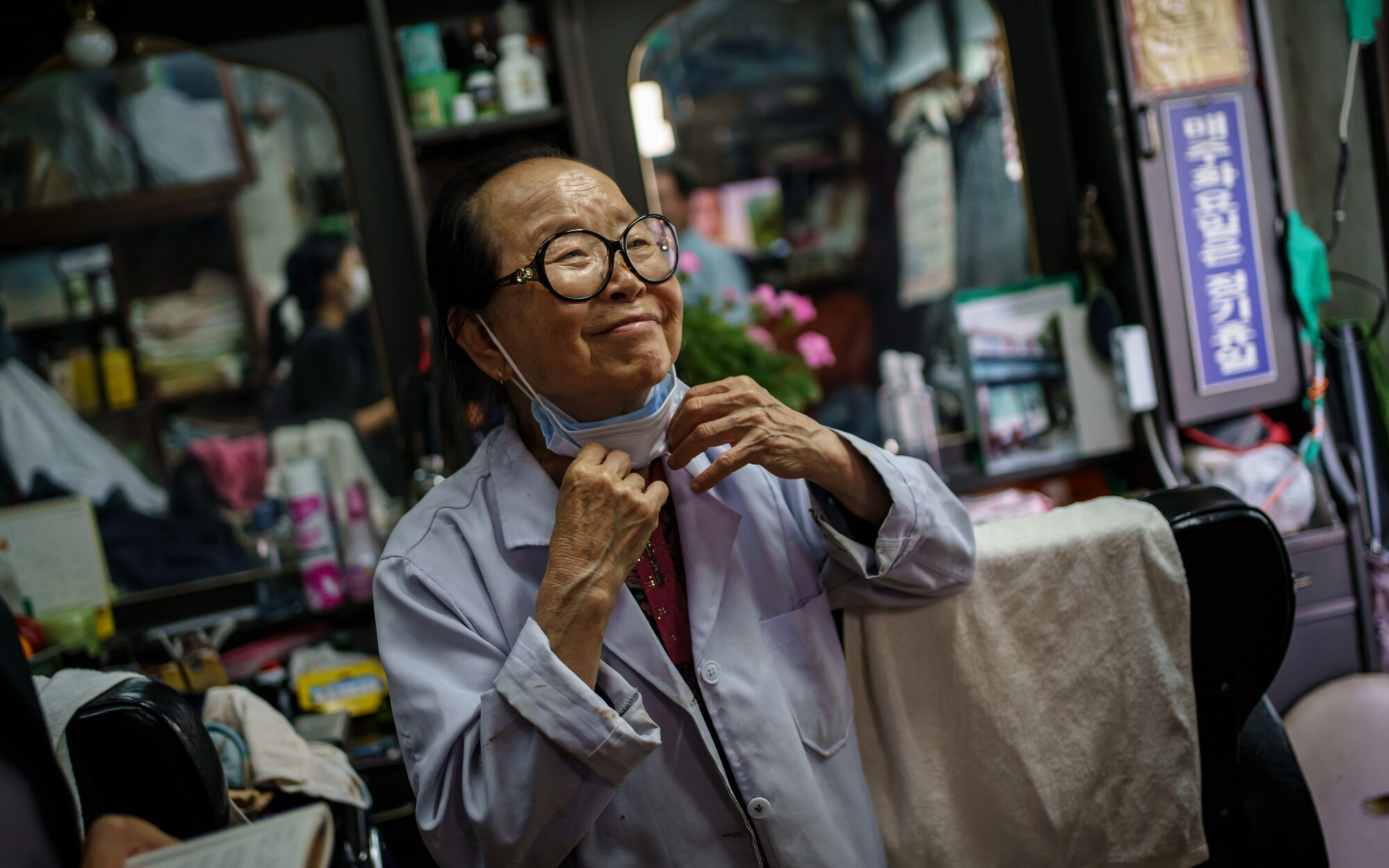 Lee Duk-hoon, 85, South Korea's first female barber, at her shop in Seoul in June 2020.