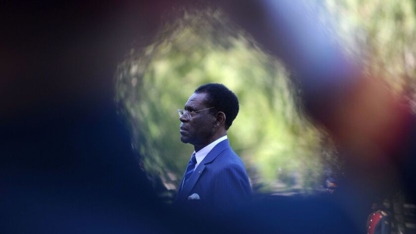 Equatorial Guinea President Teodoro Obiang Nguema Mbasogo stands during a wreath-laying ceremony at