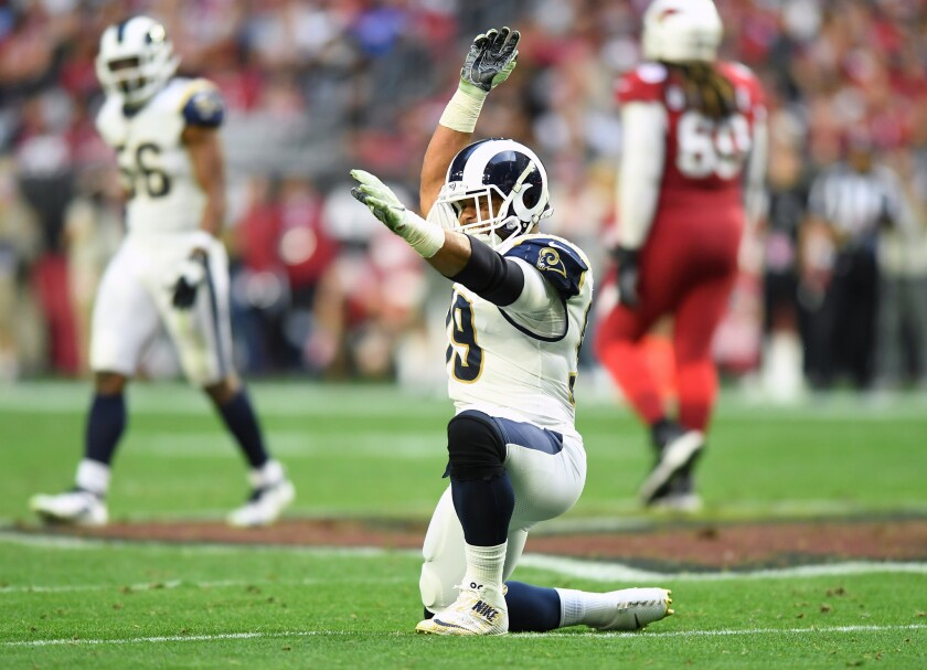 Rams defensive tackle Aaron Donald celebrates his third sack of the game against Arizona on Dec. 23.