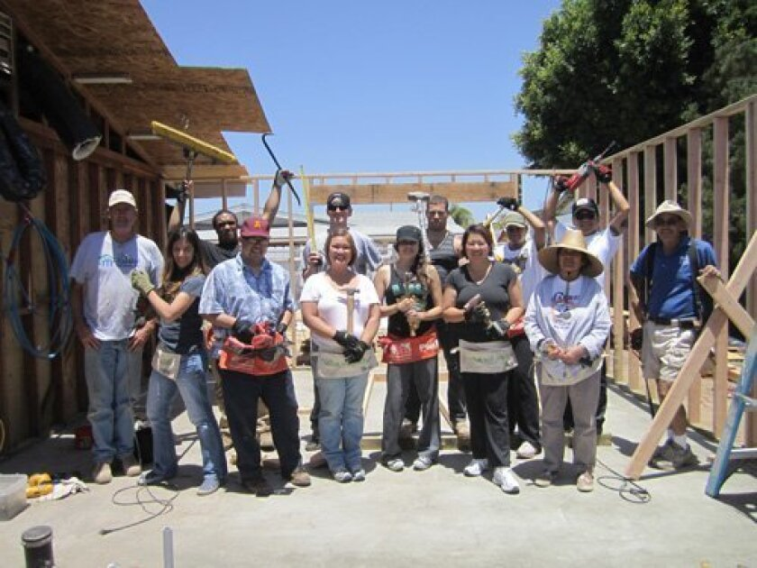 (Back row, left to right) Habitat for Humanity Project Superintendent Mike Shear, Zack Folsom, Jon Grinnell, Alex Safont, Andrea Haynes, Nam Chantepie, Habitat for Humanity Superintendent Mike Gehl; (Front row, left to right) Tracy Minutolo, Dan Ang, Janina Wills, Lissette Silva, Kim Lim, Nina Gaba