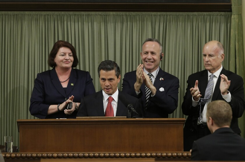 Mexican President Enrique Peña Nieto is applauded by, from left, Assembly Speaker Toni Atkins (D-San Diego), Senate President Pro Tem Darrell Steinberg (D-Sacramento) and Gov. Jerry Brown at a joint convention of the state Legislature.