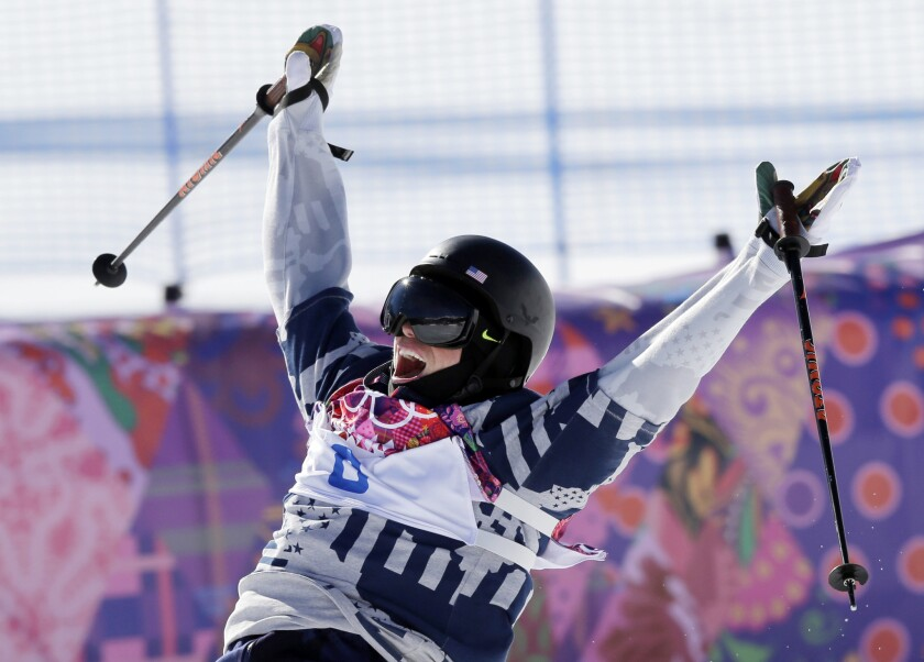 Gus Kenworthy celebrates at the end of his second run in the men's slopestyle skiing final at the 2014 Sochi Olympics, where he won a silver medal.