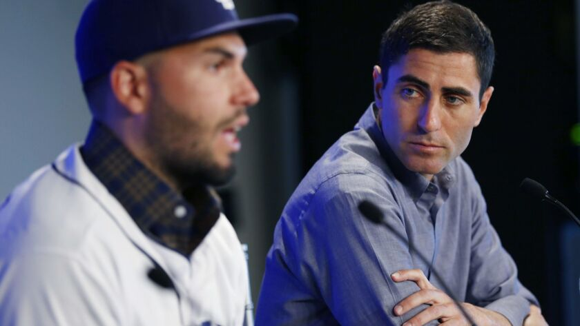 The San Diego Padres welcomed Eric Hosmer at a news conference, shown here with general manager A.J. Preller in Peoria on Feb. 20, 2018.