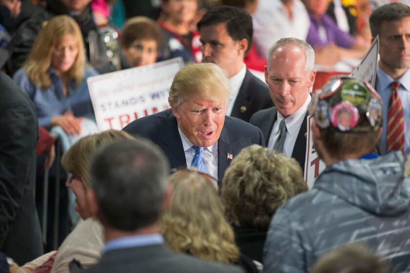 """""""People want strength,"""" Republican front-runner Donald Trump said at a rally Saturday in Davenport, Iowa."""