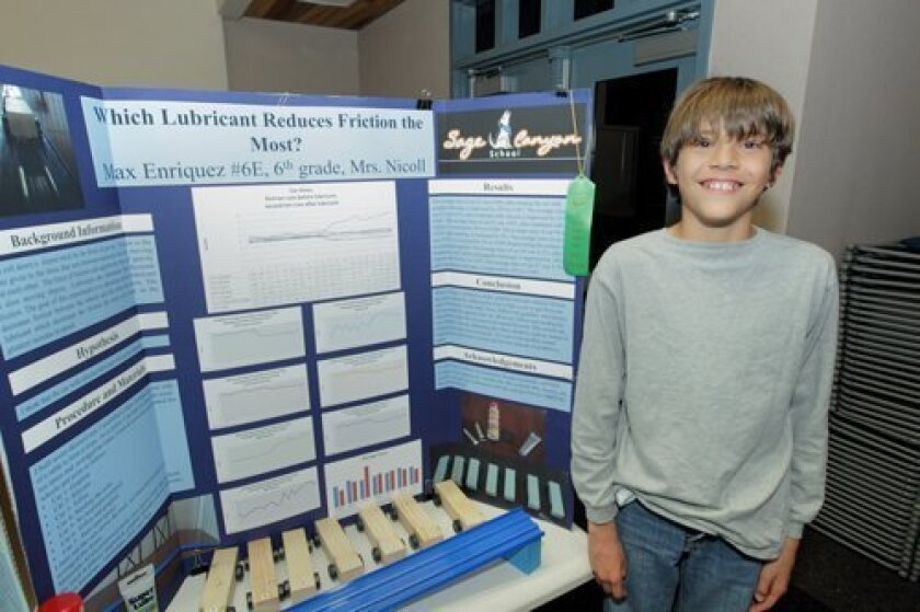 Max Enriquez with his project 'Which Lubricant Reduces Friction the Most?'