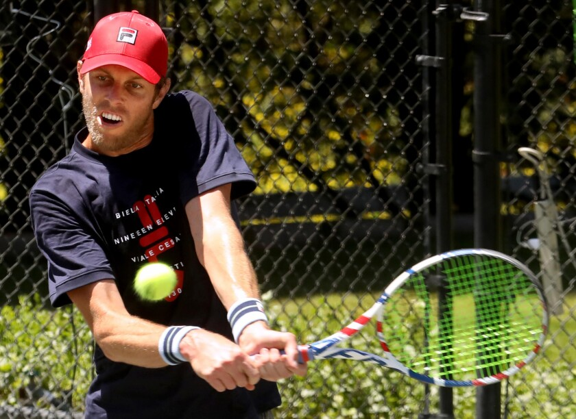 Sam Querrey returns a shot from Brandon Holt during the final round.