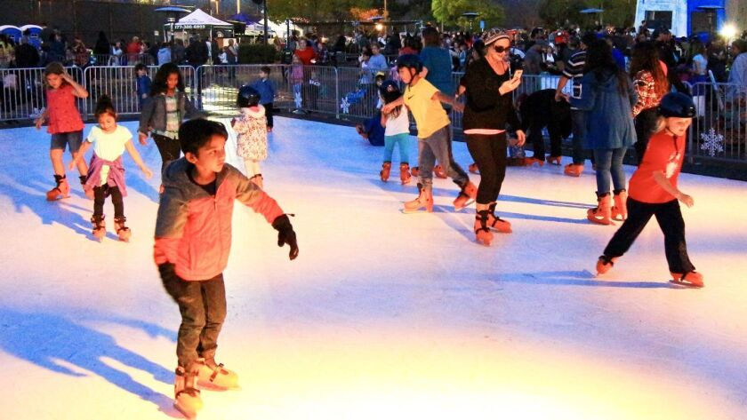 """A highlight of the Winter Festival was skating outdoors on plastic """"ice."""""""