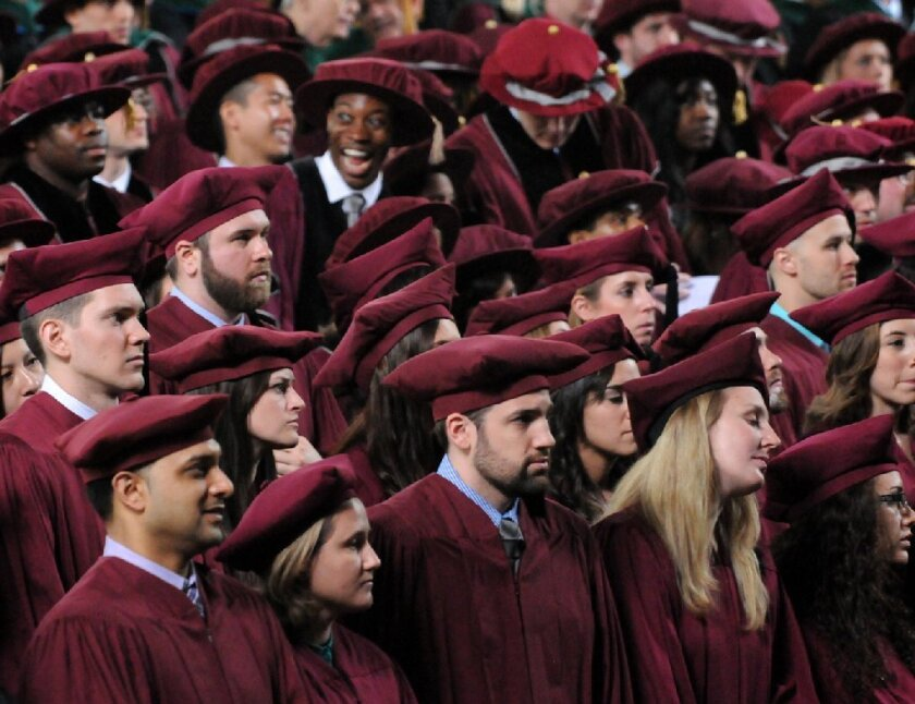 Candidates for graduation are seen listening during their Albany Medical College commencement exercises in Schenectady, N.Y. This year, several high-profile speakers declined invitations to deliver commencement addresses after facing opposition from students and faculty.