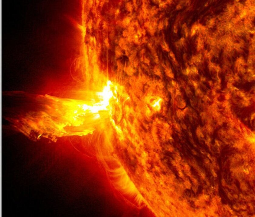 A solar flare bursts from the sun.
