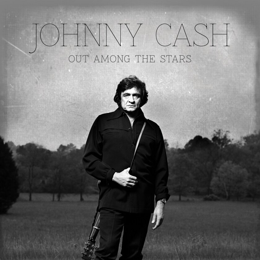 """This photo provided by Columbia/Legacy shows the Johnny Cash album cover for """"Out Among the Stars,"""" releasing March 25, 2014. The new album is comprised of 12 studio recordings by Cash that were recently discovered. (AP Photo/Columbia/Legacy)"""