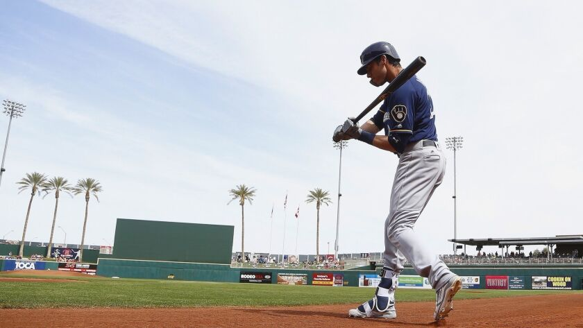 Milwaukee Brewers left fielder Christian Yelich warms up as the waits to bat prior to a spring train