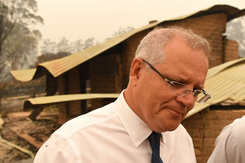 Australian Prime Minister Scott Morrison tours a farm destroyed by wildfire on Jan. 3.