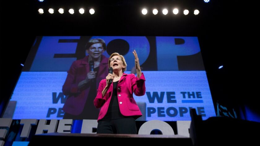 Sen. Elizabeth Warren (D-Mass.) speaks April 1 at a town hall in Washington, sponsored by two major unions and several progressive groups.