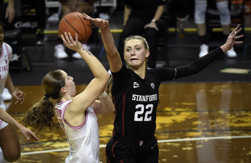 Oregon guard Taylor Mikesell (11) has her shot blocked by Stanford forward Cameron Brink (22) during the fourth quarter of an NCAA college basketball game Monday, Feb. 15, 2021, in Eugene, Ore. (AP Photo/Andy Nelson)